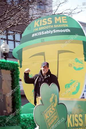 "IMAGE DISTRIBUTED FOR GILLETTE - Boston's own ""Boston Rob"" Mariano declared ""Kiss Me, I'm Smooth Shaven!"" onboard the Gillette float at the St. Patrick's Day Parade in Boston, reminding guys to K.I.S.S. - Keep It Smooth Shaven, on . A recent study revealed that 85% of women prefer to kiss a man who's smooth shaven, and that two out of three women said men will have better luck with them if they are stubble-free"