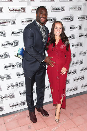 Stock Image of Prince Amukamara, left, and Pilar Davis, right, attend the Lower Eastside Girls Club Spring Benefit at the Bowery Hotel, in New York