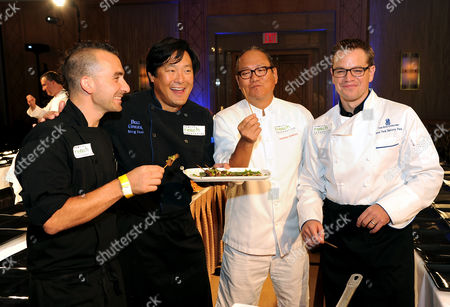 """Chefs Marc Forgione, left, Ming Tsai, Masaharu Morimoto and actor Matt Damon, right, participate in """"Cooking Live With Chef Ming Tsai and Friends"""" to benefit the Family Reach Foundation and it's mission to help families fighting pediatric cancer on in New York"""