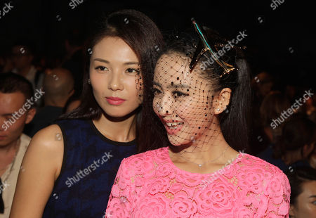 Stock Picture of Liu Tao, left, and Tong Liya, right, attend the DKNY Spring/Summer 2015 fashion show at Mercedes-Benz Fashion Week on in New York