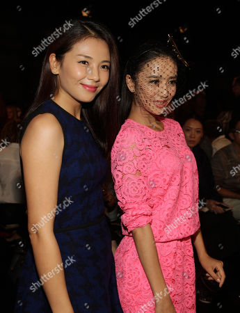 Liu Tao, left, and Tong Liya, right, attend the DKNY Spring/Summer 2015 fashion show at Mercedes-Benz Fashion Week on in New York