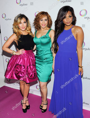 """Singer Christina Milian, left, designer Cenia Paredes and singer Adrienne Bailon attend the P&G Orgullosa """"Skirts Only"""" fashion show on in New York"""