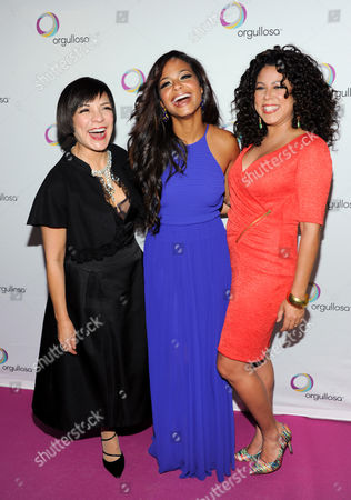 """Chocolatier Maribel Lieberman, left, singer Christina Milian and lifestyle guru Evette Rios attend the P&G Orgullosa """"Skirts Only"""" fashion show on in New York"""