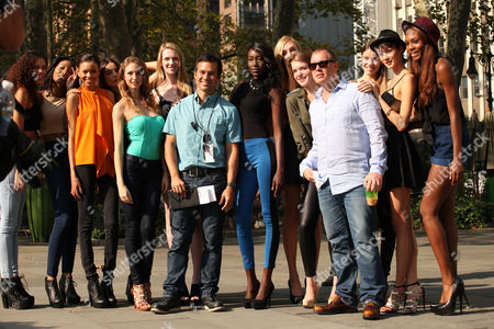 """From left, Matt Westmore Executive Producer of """"The Face"""" and Rod Aissa Senior Vice President of Original Programming and Development for Oxygen Media pose with models at the Pop Up Fashion Show during the taping of """"The Face"""" at Bryant Park on in New York"""