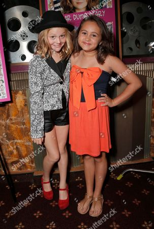 """Stock Photo of Emily Alyn Lind and Mary-Charles Jones attends the red carpet at the premiere of """"Dear Dumb Diary"""" at the Crest Theater on in Los Angeles"""
