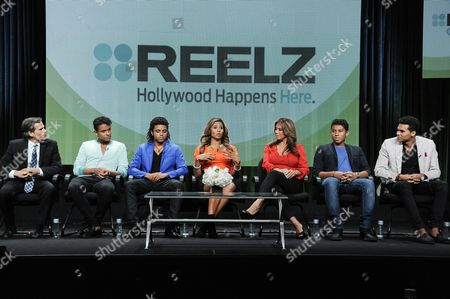 "From left, Reelz SVP of Development Rob Swartz, Jaafar Jackson, Donte Jackson, Genevieve Jackson, Alejandra Jackson, Jermajesty Jackson, and Randy Jackson Jr. speak onstage during the ""Living with THE JACKSONS"" panel at the Reelz Channel 2014 Summer TCA, in Beverly Hills, Calif"