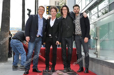 From left, Doug Davidson, Richard Marx, Rick Springfield, and Jason Thompson, attend the ceremony honoring Springfield with a star on the Hollywood Walk of Fame, in Los Angeles