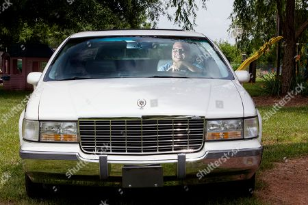 Twenty-one-year-old Ryan Harris of North Carolina and the winner of Rodney Dangerfield's 1994 Cadillac Fleetwood poses with his new car on in Kernersville, N.C. Harris won the car by entering a contest on www.rodney.com