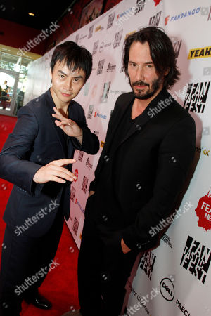 """Stock Image of Man of Tai Chi"""" director Keanu Reeves and actor Tiger Chen arrive at the 2013 Fantastic Fest US premiere of the film at the Alamo Drafthouse Cinema on in Los Angeles"""