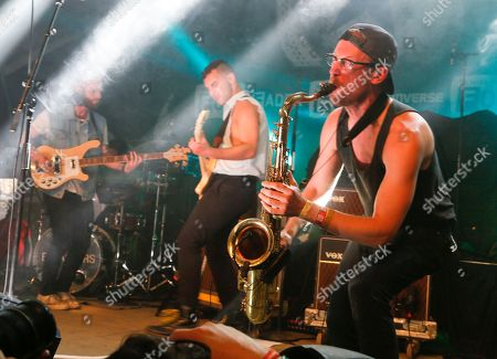 Stock Photo of Bleachers' Andrew Dost, right, performs during the SXSW Music Festival on in Austin, Texas