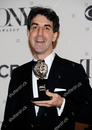 "Jason Robert Brown poses with his award for best original score for ""The Bridges of Madison County"" in the press room at the 68th annual Tony Awards at Radio City Music Hall, in New York"