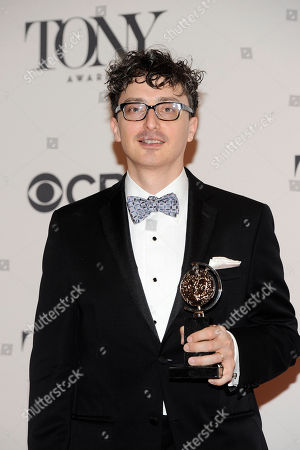 """Beowulf Boritt poses with his award for best scenic design of a play for """"Act One"""" in the press room at the 68th annual Tony Awards at Radio City Music Hall, in New York"""