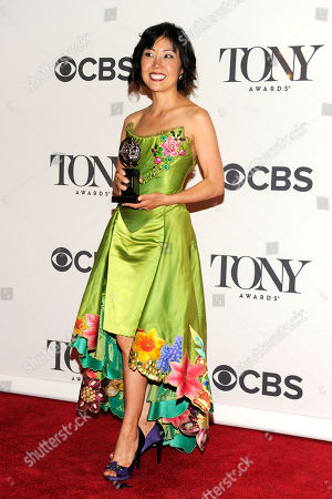 Linda Cho poses in the press room with her award for best costume design of a musical at the 68th annual Tony Awards at Radio City Music Hall, in New York