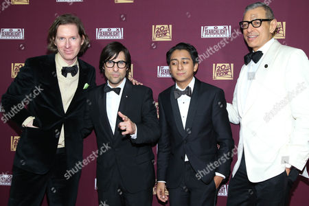 Stock Picture of CORRECTS NAME FROM TONY QUINONEZ TO TONY REVOLORI - Director Wes Anderson, from left, poses with cast members of 'The Grand Budapest Hotel' Jason Schwartzman, Tony Revolori and Jeff Goldblum attend the 87th Academy Awards - 20th Century Fox and Fox Searchlight Oscar Party at BOA Steakhouse on in West Hollywood, Calif