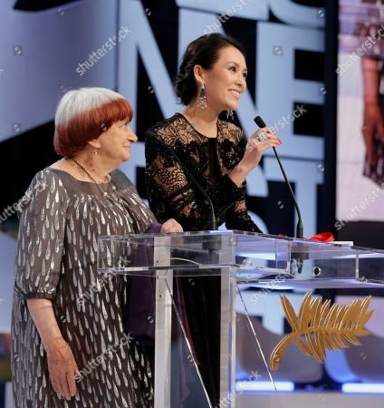 Director and jury member Agnes Varda, left, and jury member and actress Zhang Ziyi prepare to present Anthony Chen the Camera d'Or award for his film Ilo Ilo during an awards ceremony at the 66th international film festival, in Cannes, southern France
