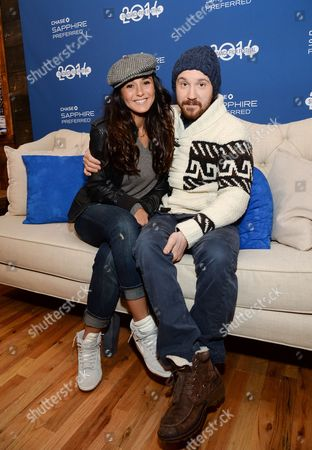 """Actors Emmanuelle Chriqui, left, and Sam Huntington from the film """"Three Night Stand"""" visit Chase Sapphire on Main Street during the Sundance Film Festival on in Park City, Utah"""