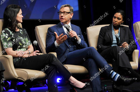 """Paul Feig, center, director of """"Bridesmaids"""" and the upcoming film """"The Heat,"""" answers a question as Amy Miles, left, CEO of Regal Entertainment Group, and Vanessa Morrison, president of Fox Animation Studios, look on during the """"Driving Financial Success: Women + Movies = Bigger Box Office"""" luncheon at CinemaCon 2013 at Caesars Palace on in Las Vegas"""