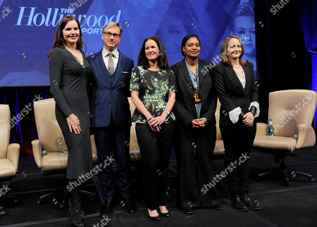 """Left to right, panelists Geena Davis, Amy Miles, Paul Feig, Vanessa Morrison and Nina Jacobson pose together following the """"Driving Financial Success: Women + Movies = Bigger Box Office"""" luncheon at CinemaCon 2013 at Caesars Palace on in Las Vegas"""