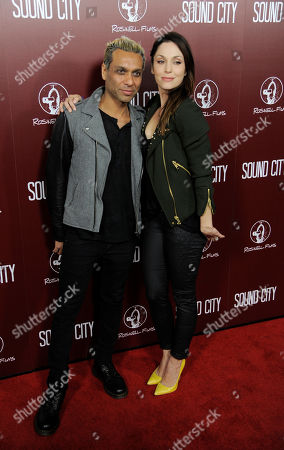 """Musician Tony Kanal and his wife Erin Lokitz pose together at the premiere of the documentary film """"Sound City"""" on in Los Angeles"""