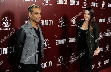 """Musician Tony Kanal, left, poses as his wife Erin Lokitz looks on at the premiere of the film """"Sound City"""" on in Los Angeles"""