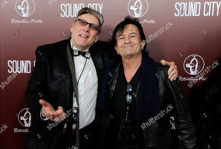 "Musicians Rick Nielsen, left, and Lee Ving pose together at the premiere of the documentary film ""Sound City"" on in Los Angeles"