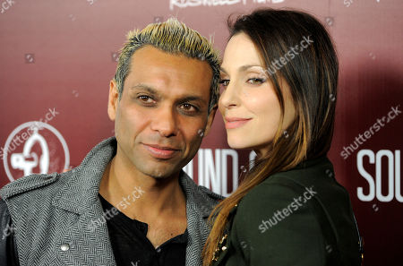 """Musician Tony Kanal and his wife Erin Lokitz pose together at the premiere of the film """"Sound City"""" on in Los Angeles"""