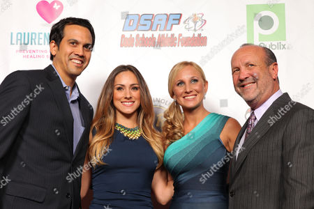 Miami HEAT Head Coach, Erik Spoelstra with guest Nikki Sapp, pose with Lauren's Kids founder, Lauren Book and father Ron Book during the Seventh Annual Reid & Fiorentino Call of the Game Dinner Presented by Publix at the Seminole Hard Rock Hotel & Casino on Saturday, March 9th, 2013 in Hollywood, Fl. Lauren's Kids is a Florida-based organization aimed at preventing child sexual abuse and healing survivors through education and awareness. The organization, headquartered in Aventura, Florida, was started by Lauren Book, M.S. Ed., a survivor of childhood sexual abuse who endured abuse at the hands of her nanny for six years