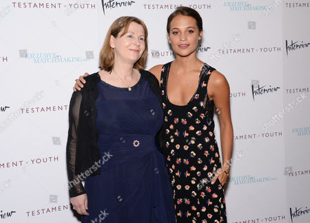 "Producer Rosie Alison, left, and actress Alicia Vikander attend the premiere of ""Testament of Youth"" at the Bow Tie Chelsea Cinemas, in New York"