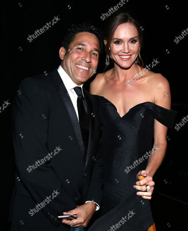 Oscar Nunez, left, and Erinn Hayes attend night two of the Television Academy's 2016 Creative Arts Emmy Awards at the Microsoft Theater on in Los Angeles