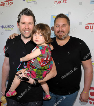 Bill Horn, left, Scout Masterson, right, and their daughter attend The HollyRod Foundation's 3rd Annual My Brother Charlie Family Fun Festival at Culver Studios, in Culver City, Calif