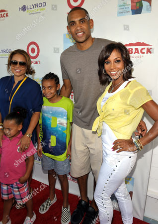 Tamia Hill, left, Grant Hill, second right, and Holly Robinson Peete, right, and the Hill children attend The HollyRod Foundation's 3rd Annual My Brother Charlie Family Fun Festival at Culver Studios, in Culver City, Calif