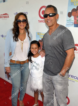 Leah Remini, left, Angelo Pagan, right, and their daughter attend The HollyRod Foundation's 3rd Annual My Brother Charlie Family Fun Festival at Culver Studios, in Culver City, Calif