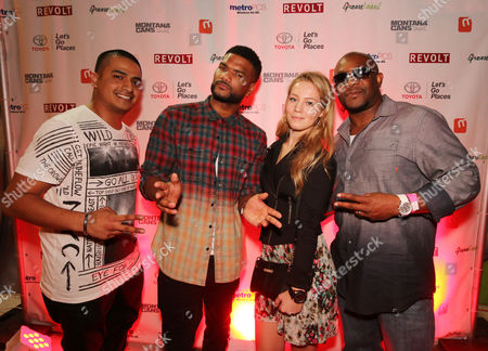 Damien Wayans (2-L) poses for a photo at the #REVOLTBlendedCultures event at Art Basel, in Miami Beach, Florida