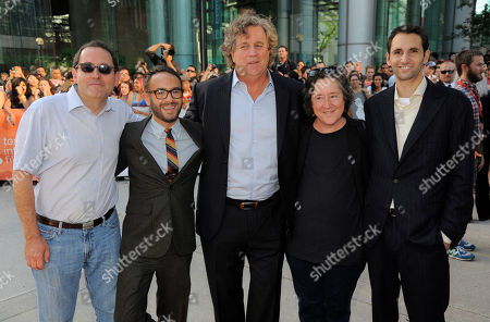 """Stock Photo of John Krokidas, second from left, director of """"Kill Your Darlings,"""" poses with Sony Pictures Classics co-presidents Michael Barker, far left, and Tom Bernard, center, producer Christine Vachon, second from right, and executive producer Michael Benaroya at the premiere of the film on day 6 of the 2013 Toronto International Film Festival at Roy Thomson Hall on in Toronto"""