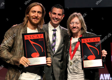 """Stock Photo of ASCAP Senior Director, Membership - Pop/Rock Marc Emert-Hunter (c), songwriter David Guetta and songwriter Frederic Riesterer who received the ASCAP Pop Song Award for """"Without You"""" are seen onstage at the 30th Annual ASCAP Pop Music Awards,, at Loews Hollywood Hotel in Hollywood, California"""