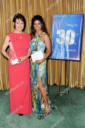 Ivonne Coll, left, and Andrea Navedo attend the 30th Annual Imagen Awards press room held at the Dorothy Chandler Pavilion, in Los Angeles