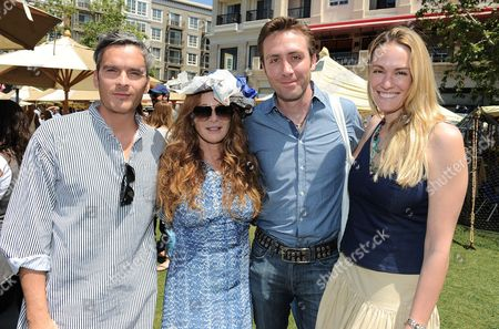 From left, Balthazar Getty, Kimberly Muller, Philippe Cousteau and Ashlan Gorse attend the Earth Day Celebration at The Americana at Brand in Glendale, CA benefitting Philippe Cousteau's EarthEcho on