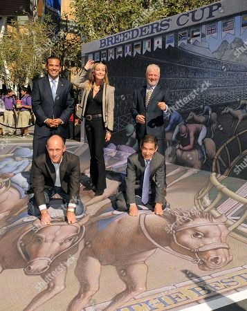 Jockeys Gary Stevens, front left, and Laffit Pincay Jr., front right, are joined by, from left, Los Angeles Mayor Antonio Villaraigosa, Breeders' Cup Ambassador Bo Derek and Keith Brackpool, Chairman of the California Horse Racing Board, atop a 3D street painting by artist Kurt Wenner following a news conference to announce the official return of the Breeders' Cup World Championships to the city of Los Angeles,, in Los Angeles