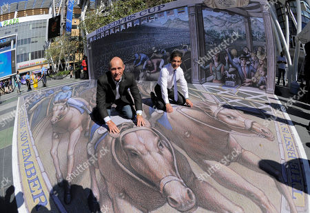 Stock Photo of Jockeys Gary Stevens, left, and Laffit Pincay, Jr. pose atop a 3D street painting by artist Kurt Wenner following a news conference to announce the official return of the Breeders' Cup World Championships to the city of Los Angeles,, in Los Angeles