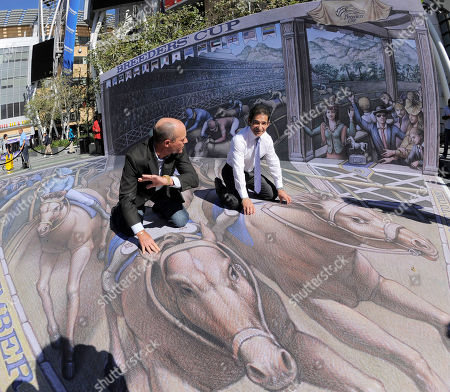 Jockeys Gary Stevens, left, and Laffit Pincay, Jr. pose atop a 3D street painting by artist Kurt Wenner following a news conference to announce the official return of the Breeders' Cup World Championships to the city of Los Angeles,, in Los Angeles