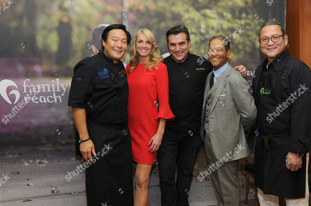 Chef Ming Tsai, Family Reach National Advisory Board President, Carla Tardif, CEO, Family Reach, chef Todd English, veteran broadcaster Bryant Gumbel and Iron Chef Morimoto, left to right, attend Family Reach's Cooking Live! charity event, at The Ritz-Carlton New York, Battery Park. The event raises funds to help families fighting pediatric cancer