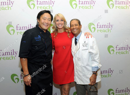 Chef Ming Tsai, left, Family Reach National Advisory Board President, Carla Tardif, center, CEO, Family Reach, and veteran broadcaster Bryant Gumbel, right, host Family Reach's Cooking Live! charity event, at The Ritz-Carlton New York, Battery Park. The event raises funds to help families fighting pediatric cancer