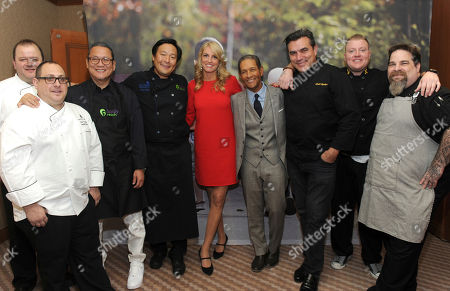 Chefs Philip Medora, Alan Dancyger, Masaharu Morimoto, Ming Tsai, Todd English, Brett Portier and Eric Le Vine, left to right, with Carla Tardif, center, CEO, Family Reach, and veteran broadcaster Bryant Gumbel, center right, attend Family Reach's Cooking Live! charity event, at The Ritz-Carlton New York, Battery Park. The event raises funds to help families facing the daily cost of cancer