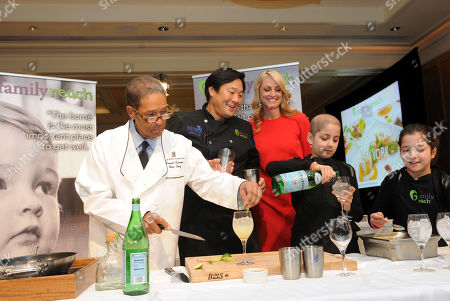 Veteran broadcaster Bryant Gumbel, chef Ming Tsai, Family Reach National Advisory Board President, Carla Tardif, CEO, Family Reach, and twins Olivia and Sabrina Lorusso, left to right, attend Family Reach's Cooking Live! charity event, at The Ritz-Carlton New York, Battery Park. The event raises funds to help families facing the daily cost of cancer