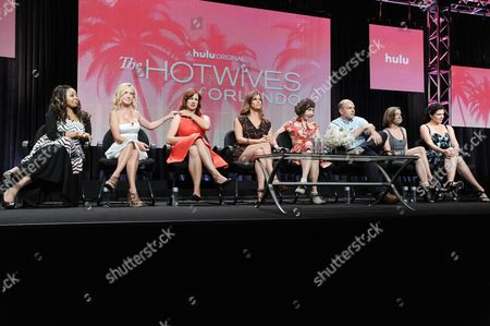 "Actresses Tymberlee Hill, Angela Kinsey, creator/actress Dannah Feinglass Phirman, actresses Andrea Savage, Kristen Schaal, executive producer Paul Scheer, creator/actress Danielle Schneider and actress Casey Wilson speak onstage during the ""The Hotwives of Orlando'"" segment of the the Hulu 2014 Summer TCA, in Beverly Hills, Calif"