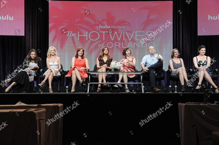 "Stock Image of Actresses Tymberlee Hill, Angela Kinsey, creator/actress Dannah Feinglass Phirman, actresses Andrea Savage, Kristen Schaal, executive producer Paul Scheer, creator/actress Danielle Schneider and actress Casey Wilson speak onstage during the ""The Hotwives of Orlando'"" segment of the the Hulu 2014 Summer TCA, in Beverly Hills, Calif"