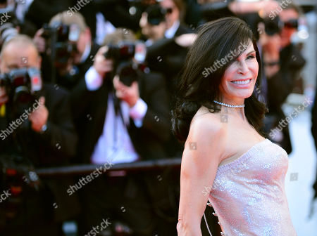 Mouna Ayoub poses for photographers on the red carpet for the screening of Mr. Turner at the 67th international film festival, Cannes, southern France