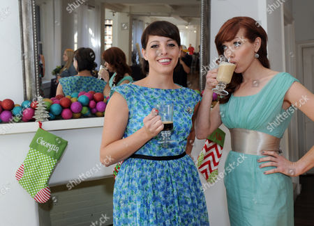 Mixologists and Cooking Channel stars Georgia Hardstark, left, and Alie Ward, right, sip an espresso and a creamy layered latte at the NESCAFE Dolce Gusto holiday entertaining event in New York