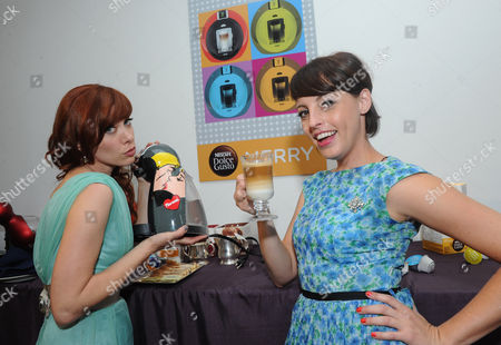 Mixologists and Cooking Channel stars Alie Ward, left, and Georgia Hardstark pose with a limited edition NESCAFE Dolce Gusto Fiorucci Genio machine during their holiday entertaining event in New York