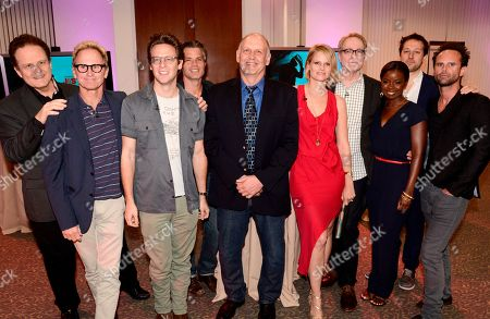 """Tom O'Neill, and from left, Jere Burns, Jacob Pitts, Timothy Olyphant, Nick Searcy, Joelle Carter, Fred Golan, Erica Tazel, Dave Andron and Walton Goggins attend """"An Evening with Justified"""", at the Television Academy in the NoHo Arts District in Los Angeles"""